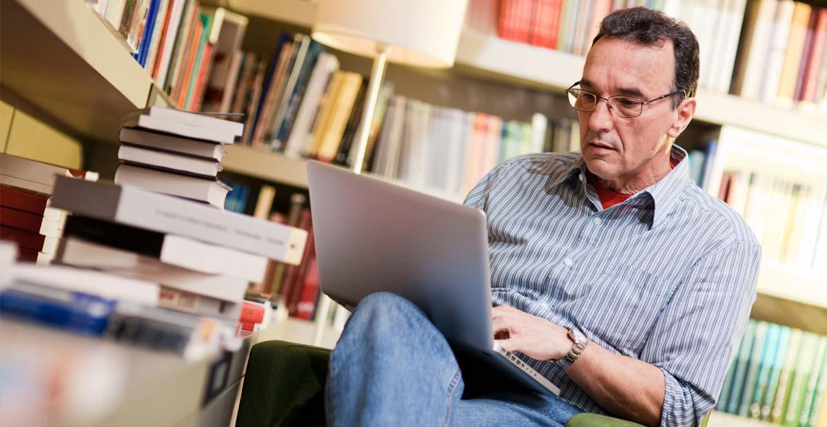 Man researching on laptop